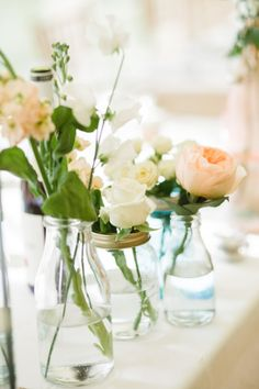 Boutique Blooms: Boutique Blooms Floral Design & Styling. Top Table display of single blooms in vintage mason jars and bud vases. With peach Juliet roses. Surrey wedding. Photo credit: Lola Rose Photography