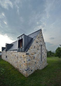 This farmhouse was designed by 3+1 architekti for a client who wanted to return to...