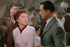 WATCH & PIN! Pop Culture Crossing reviews MGM's 1951 Best Picture winner & musical, 'An American in Paris'! The movie stars Gene Kelly and Leslie Caron & features music from George Gershwin and Ira Gershwin.