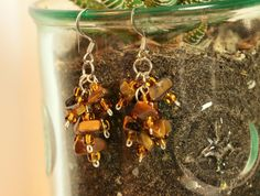 Perfect gift for any occasion!!! Birthdays, anniversaries, bridesmaid jewelry, you name it! Make sure you buy an extra pair because Im sure youd want to keep one for yourself!  This daring semi-precious stone tigers eye cluster earring will surely give you that extra sharpness paired with your favorite brown outfit! According to Healing Crystals for You, Tigers Eye Stone is a crystal with lovely bands of yellow-golden color through it. This is a powerful stone that aids harmony and balance…