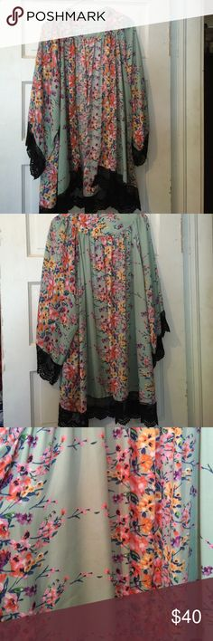 Floral Kimono with Crocheted detail This is a long floral kimono with black crotchet details. It is a M/L in size. Fun and cute! It has no tags but has never been worn only tried on when bought. Tops