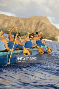 Stock Photo : Hawaii, Oahu, female outrigger canoe team paddling towards Diamond Head.