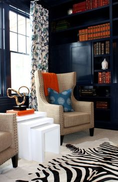 South Hampton Interior Design, Navy Painted Built in bookshelves, China Seas, Orange and Blue