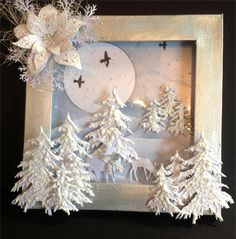 Card made by Martine using Impression obsession Fir Trees ! Deers memory box Poinsetta and flying birds Martha Stewart punch Branch . All co...