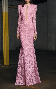 This Alex Perry gown features full length sleeves, an illusion cut out at the bodice, and a full length skirt.