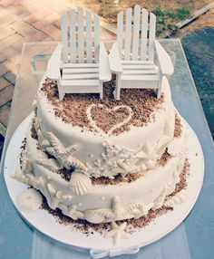 pretty beach wedding cake with cute chair cake toppers