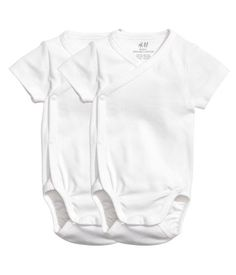 White. CONSCIOUS. Short-sleeved wrapover bodysuits in soft organic cotton jersey with snap fasteners at side and at gusset.