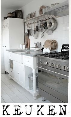 Lovely big range cooker and clean white cupboards.