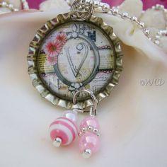 bottle cap art = necklace pendant/charm.