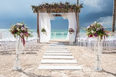 Beautiful floral and contemporary set up on the Beach Pergola here at Secrets Akumal Riviera Maya! #SecretsAkumalRivieraMaya #DestinationWedding #BeachWedding #MexicoWedding