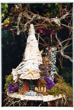 Fairy Penthouse - Fairy House by Nancy Ames featuring a seashell chimney, purple flowers, and a birch roof. Photo by Mary Liz Lancaster Fairy Houses, Lancaster, Natural Materials, Purple Flowers, Cottages, Birch, Sea Shells, Gingerbread, Whimsical