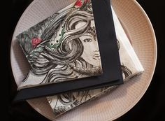 """Vallila designs for Duni napkin from """"Merenneito"""" pattern."""