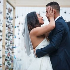 """In the Japanese culture it's a tradition to make 1000 origami cranes and display them at the wedding. We decided to hang ours up on our altar and say our vows beneath them."" More on the blog!  by @craigobrist  #munaluchibride #munaluchi #love #wedding #culture"