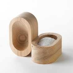 """Two of our favorite things come together in a play on words and materials. Made in Oregon from solid ash with a natural finish that wears beautifully over time. Each piece has unique wood grain patterns and texture. Diagonal sloped bowl interior ensures salt gathers for a perfect pinch of salt.    4"""" L x 2 3/4"""" W x 2"""" H    designed by Christopher Bleiler 