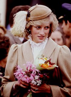 Diana Princess of Wales on a walkabout through the city centre of Christchurch, during the Royal Tour of New Zealand on April 1983 in New Zealand. Princess Diana wore a coat designed by Caroline. Get premium, high resolution news photos at Getty Images Princess Diana Photos, Princess Of Wales, Lady Diana Spencer, Diana Fashion, 80s Fashion, Fashion 2020, Fashion Ideas, Isabel Ii, Stylish Hats