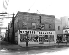 Front view of the Gazette Telegraph building on Pikes Peak Avenue. Megel's Jewelry Store is next door.