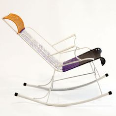 Marni is entering the furniture business with a line of chairs — but instead of plush chaise lounges upholstered with its signature prints, it hired ex-prisoners to make metal chairs covered in multicolored plastic netting.    These are made by former Colombian prison inmates in aid to help them readjust to social and working life.