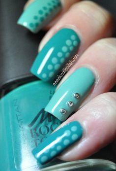 Light and medium teal dot with dots & rhinestones nail art design