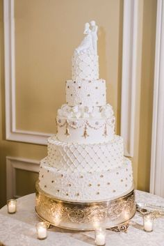 Elegant five tier white wedding cake with gold decoration; Featured Photographer: Rebecca Yale Photography