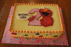Yellow Sesame Street Elmo birthday sheet cake with colorful polka dots