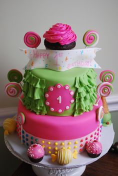 Sweet Shoppe Theme - Sweet Shoppe Cake with ruffles, lots of candy, cake truffles made into ice cream cones and candy