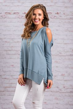 We have caught all the feelings for this mocha top! It's super soft jersey knit fabric and loose, slouchy-chic cut go hand in hand! This casual top also features slit cold shoulder detailing which is right on trend!  Material has generous amount of stretch. Chelsea is wearing the small. Sizes fit: Small- 0-4; Medium- 6-8; Large- 10