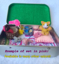 Miniature cat in a tin set https://www.etsy.com/listing/233573205/miniature-felt-plush-cat-in-altoid-tin