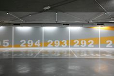 Car Park Plaza Canovas, Valencia by Teresa Sapey. The design provides the city and its inhabitants with sustainable and eco-friendly space. The drawings covering the walls refer to various parts of the city of Valencia and indicate the route and the time it takes you to walk there. Each place shown on each of the four floors is classified by four colors: water (blue), green spaces (green), cultural spaces (red) and leisure activities (orange / yellow). The lighting design completes the…