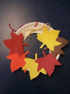 fall kid craft paper plate and leaf wreath ! - cc made this and then we each wrote out what we were thankful for on the leaves!