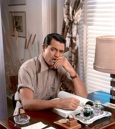 """archiesleach: """" Cary Grant photographed in his study, 1939. """""""