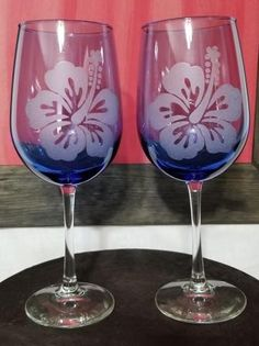 Large blue ombra wine glass with flower etched on it.