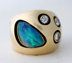love the deep settings!  Gold, Opal, Diamond Ring