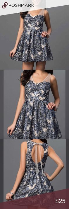 Navy Blue Sequin short Size 5 Dress by As U Wish Sparkling sequins make this open-back party dress an eye-catching choice for your next semi-formal event. This As U Wish short designer dress features a unique navy-blue sequin pattern that resembles layered leaves on a nude background. The sweetheart bodice of this dress is fitted with sheer-chiffon shoulder straps and a band at the natural waist over a full gathered skirt. The back of this cute short dress presents a flirty key-hole opening…