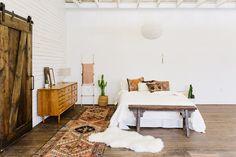 Vintage textiles and handmade goods create this Boho nursery by Loom + Kiln