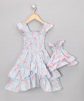 """In this dress duo, little ladies and their favorite dollies are ready for the finest tea or garden parties.A smocked bodice and tiered skirt create a silhouette filled with feminine fancy. Angel sleeves and a girly pattern mean gals and dolls are dressed to impress.Includes dress and doll outfitFits most 18"""" dolls100% ..."""