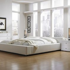 White bedroom design ideas come with white bed and white bed sheet also double white stained nighstand with modern table lamp plus white wall painted a part of under Bedroom