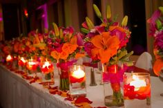 New Orleans Themed Flowers | use bridal party bouquets as centerpieces for wedding head table ...