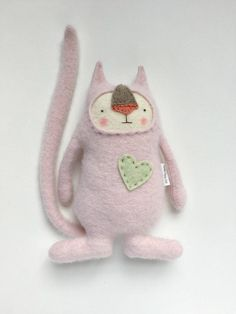 Stuffed Animal Cat Upcycled Sweater Repurposed  I made this guy from a beautiful pale, pale pink 100% cashmere sweater. Such a lovely, lovely color and oh so soft. I just love working with pink sweaters. They are simply too few and far between. Something about this kitty makes me smile, such a sweet expression. He is just over 8 inches tall and about 7 inches wide.  If you are outside of the US your country may charge you extra taxes and fees. If you are in the UK you will almost certainly…
