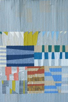 Doe couch quilt with Aerial, Totem and Focal blocks . Carolyn Friedlander