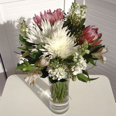 Grouped posy arranged in vase- Alstromeria, Stock, Disbud Chrysanthemum, Ivy Berry, Protea © flowers for daisy
