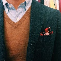 Dark grey tweed jacket, light blue OCBD, beige sweater