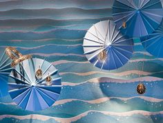 """Tiffany & Co celebrates """"Carefree Days by the Sea"""" using soft colored parasols for their summer window displays. Fashion Window Display, Window Display Design, Shop Window Displays, Merchandising Displays, Tiffany And Co, Jewellery Display, Jewelry Shop, Decoration, Store Design"""