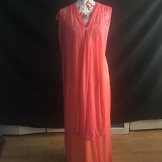 Long Ball Gown Coral long ball gown with crystals on the chest, has a little snag please look at last picture and ask questions Dresses