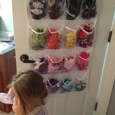 Organize hair accessories with over the door shoe organizer. So easy and kids can reach it! I'm loving it !