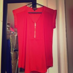 Express red zipper blouse Never worn before red zipper top from express. Condition is basically new! Would Look great with skinny jeans and heels or under a suit jacket! Express Tops Blouses
