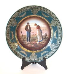 Antique Royal Vienna Portrait Plate with Hand Painted Farm Couple Green and Gold Cabinet Plate - Early 1900's  by HouseofLucien