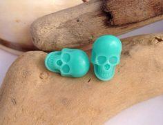 Caribbean green skull earrings. Surgical steel studs.