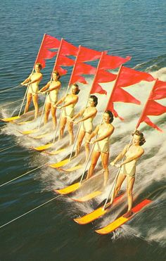 Beauty on Parade: The Aquamaids of Cypress Gardens skied four daily water ski shows and really exemplify the youthful spirit of Florida as they skim over the water in formation.