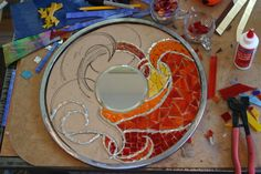 Love the way this mosaic is progressing. Love how each section is outlined with mirror tiles before filling with glass.