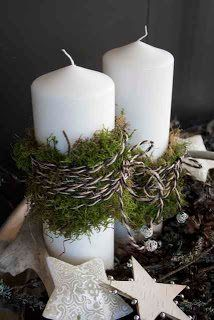 Pillars wrapped in moss with twine.